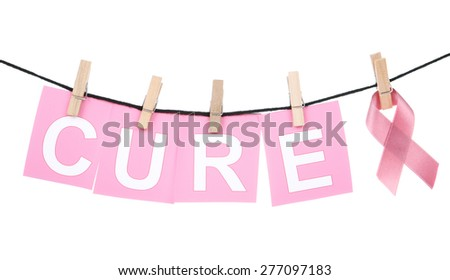 Breast Cancer Awareness ribbon and the word cure pinned to line - stock photo
