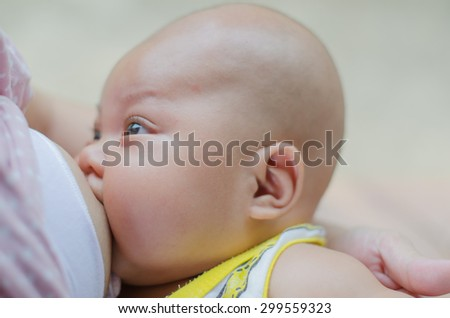 Breast feeding mother and baby - stock photo