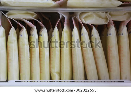 breast milk storage bags for new baby in refrigerator - stock photo