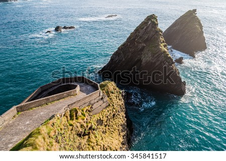 Breath taking scenery on the west cost of Ireland, top of the Slea Head drive on the Dingle peninsula in sunset of lovely April sunny day. - stock photo