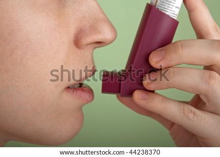 Breathing asthmatic medicine healthcare inhaler - stock photo