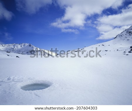 Breathing Hole in Ice - stock photo