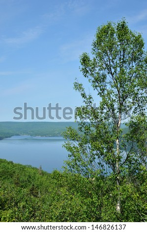 Breathtaking view of Bras d'or Lake in Nova Scotia, Canada, on a summer day - stock photo