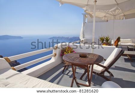 Breathtaking view of the caldera from a balcony in Imerovigli, Santorini, Greece. - stock photo