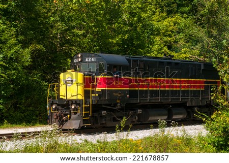 BRECKSVILLE, OH - SEPTEMBER 7, 2014: A diesel locomotive chugs by on the Cuyahoga Valley Scenic Railroad, which runs daily excursions through Cuyahoga Valley National Park between Cleveland and Akron. - stock photo