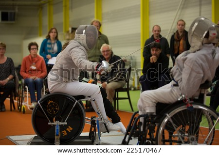 BREDA, NETHERLANDS - OCTOBER 12 : Dutch physically disabled athletes fencing during the Paragames, a big bi-yearly event on OCTOBER 12, 2013 in BREDA, NETHERLANDS - stock photo