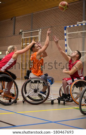 BREDA, NETHERLANDS �¢?? OCTOBER 12 : Dutch physically disabled athletes playing wheelchair basketball during the Paragames, a big bi-yearly event on OCTOBER 12, 2013 in BREDA, NETHERLANDS - stock photo