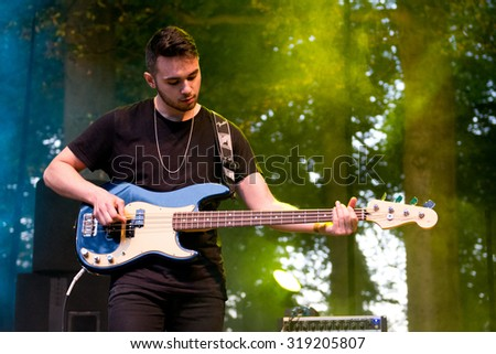 BREDA, THE NETHERLANDS - SEPTEMBER 20, 2015 - Harry Roche of As ELephants Are performs live on stage at Breda Barst festival - stock photo