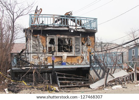 BREEZY POINT, NEW YORK- FEBRUARY 7: Devastated area in Breezy Point, NY three months after Hurricane Sandy on February 7, 2013. More than 80 houses were destroyed in out-of-control six-alarm blaze. - stock photo
