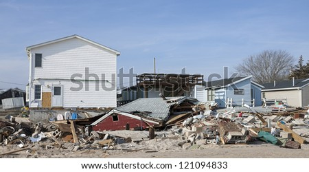 BREEZY POINT, NY - DECEMBER 3:After more than a month from Hurricane Sandy no major reconstruction work began on Oceanside Drive at Breezy Point, New York, U.S., on Monday, December 03, 2012. - stock photo