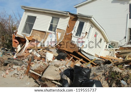 BREEZY POINT, NY - NOVEMBER 20: Destroyed  beach house in the aftermath of Hurricane Sandy on November 20, 2012 in Breezy Point, NY - stock photo