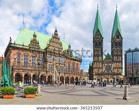 BREMEN, GERMANY - MAY 26, 2015: Market Square with Town Hall and Cathedral. In July 2004 the part of square consisting of the Roland Statue and the Town Hall was listed as a UNESCO World Heritage Site - stock photo
