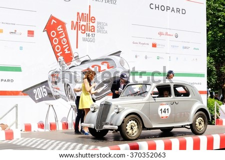 BRESCIA (BS), ITALY - MAY 17: A gray Lancia Ardea arrives at the 1000 Miglia classic car race on May 17, 2015 in Brescia (BS). The car was built in 1939. - stock photo