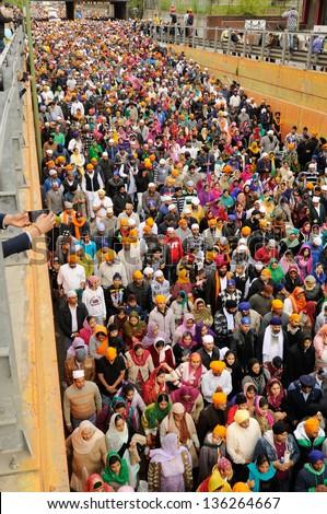 BRESCIA ITALY - APRIL 20: Crowd of sikh devotees take part to Baisakhi procession (high POV) on April 20, 2012 in Brescia - stock photo