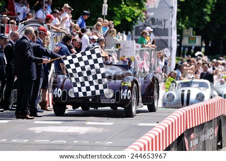 BRESCIA, ITALY - MAY 18: A dark red Alfa Romeo 6C 2300 B MM spider touring finishes the 1000 Miglia classic car race on May 18, 2014 in Brescia. The car was built in 1938 - stock photo