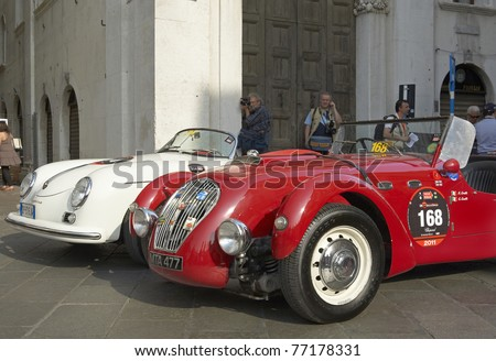 BRESCIA,ITALY - MAY,12: a Healey Silverstone   from 1950 and a Porsche 356 1500 Speedster of 1955 at the punching of Mille Miglia,the famous race for historic cars,May 12,2011 in Brescia,Italy - stock photo