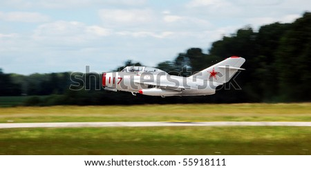 BRESLAU, ON, CANADA - JUNE 20: A Mig-15, a Russian aircraft type that won fame during the Korean War, takes off at the Waterloo Aviation Expo and Air Show on June 20, 2010 in Breslau, Ontario. - stock photo