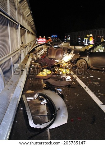 BRESSANONE BRIXEN, ITALY - JANUARY 12, 2009: Terrible deadly car crash accident after a frontal collision between two cars on the road in the night in Bressanone Brixen on January 12, 2009 - stock photo