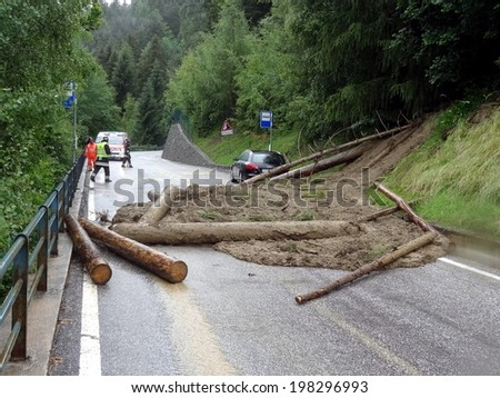 BRESSANONE , ITALY - JUNE 9:  the scene of Landslide with falle tree on a mountain street in Bressanone on June 9, 2014 - stock photo