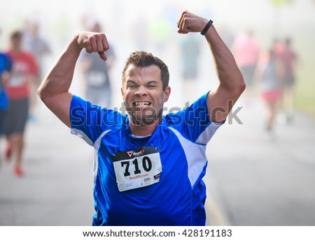 BREVARD, NC-MAY 28, 2016 -Athlete Russel Wagner of Atlanta, GA, runs in the White Squirrel Race with over 350 runners in Brevard, NC 2016.  Race is sponsored by Rotary Club of Brevard, NC - stock photo