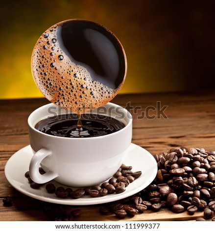Brewed coffee pours into the cup. - stock photo