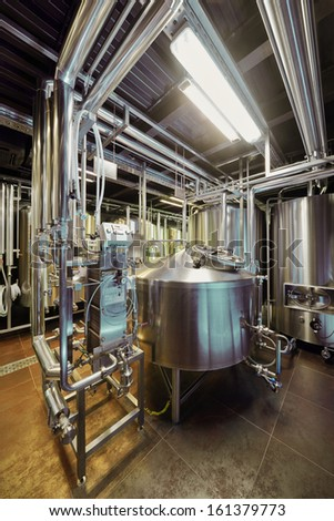 Brewery equipment in microbrewery - stock photo