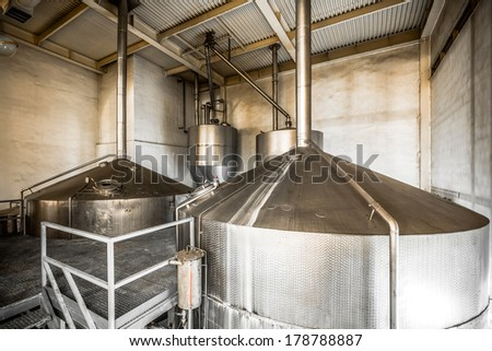 Brewing production - fermentation department, the interior of the brewery - stock photo