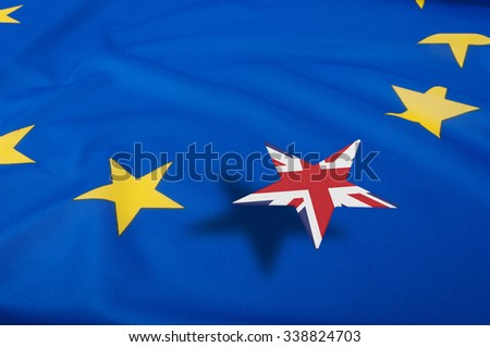 Brexit - European Union Flag Drapery With Great Britain Leaving  - stock photo