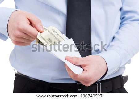 Bribe. Cropped image of man in shirt and tie taking money from the envelope while standing isolated on white - stock photo