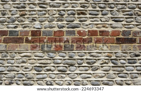 Brick and pebble or flintstone wall - stock photo
