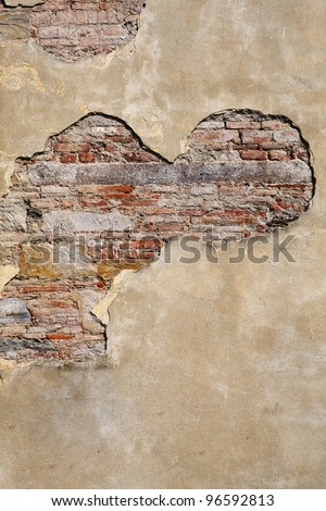 Brick and stucco make interesting, contrasting textures in an old wall, with lots of copy space. - stock photo
