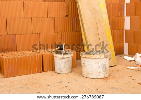 Brick by Brick,  build a house on your own. Building a home. House under construction. Preparing a malt. - stock photo