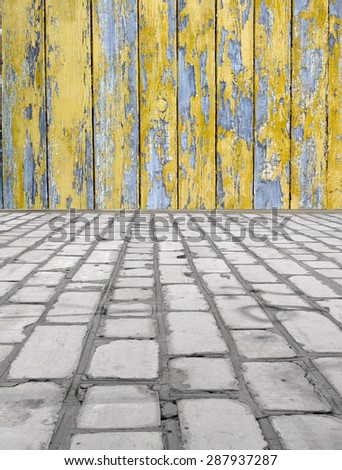 brick floor with a wooden wall - stock photo