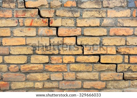 Brick foundation with a crack in the mortar                                - stock photo