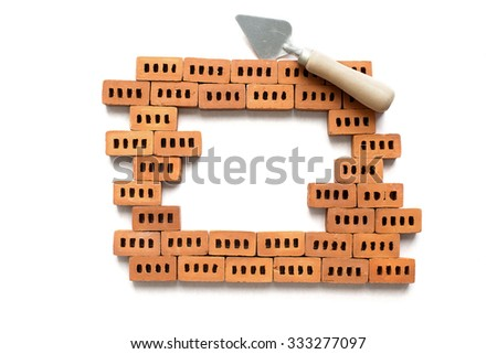 brick frame. frame of bricks and pickaxes on a white background - stock photo
