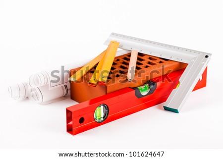 brick, mason tools and construction plans isolated on white background - stock photo