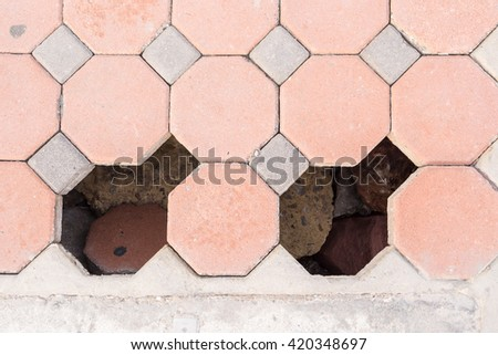 brick octagonal walkway pavement collapse and hole - stock photo
