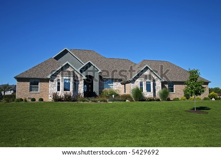 Brick Ranch With Stone Accents Stock Photo