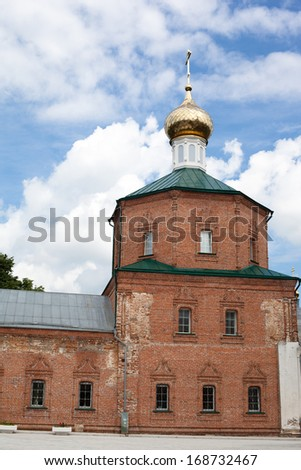 Brick red orthodox church with one golden dome  - stock photo
