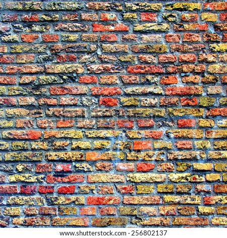 brick solid stone wall with warm colors  - stock photo