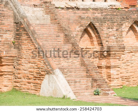 brick stairs on the wall of pagoda - stock photo