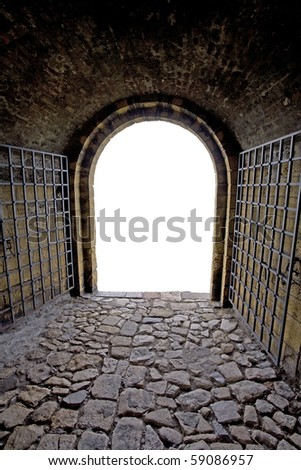 Brick tunnel with gate. Isolated exit. - stock photo