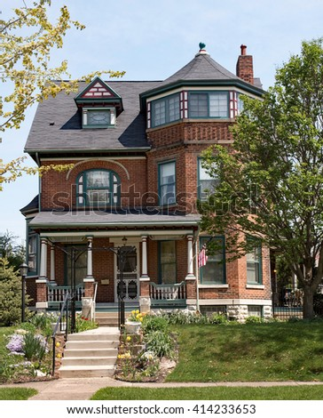 Brick Victorian House with Turret  - stock photo
