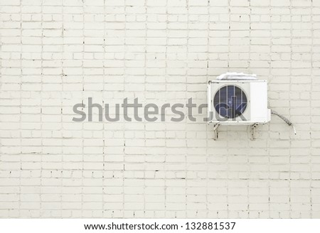Brick wall and Air Conditioner - stock photo