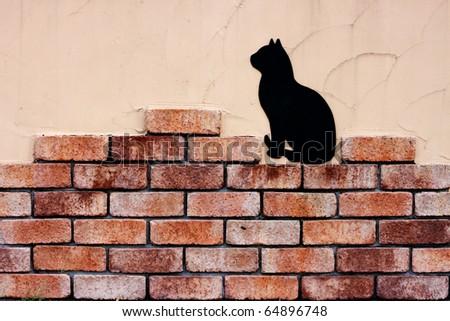 Brick wall and cat - stock photo