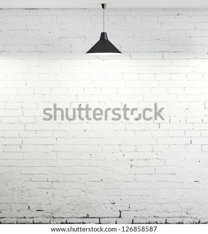 brick wall and ceiling lamp - stock photo