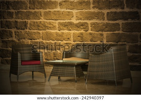Brick wall and furniture Decoration - stock photo