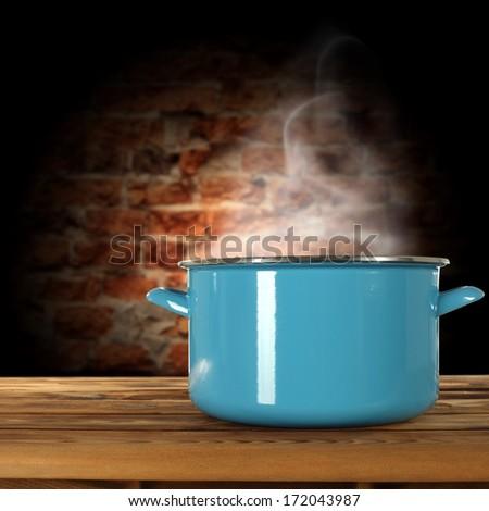 brick wall and hot pot  - stock photo