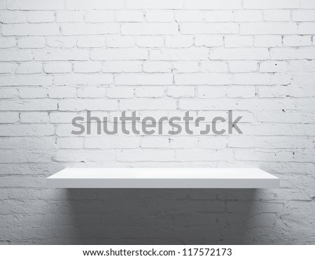 brick wall and white shelf - stock photo