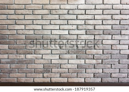 Brick wall Brick wall background texture with brown trim - stock photo